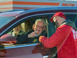 Volunteer Adam Hegewald greets a donor